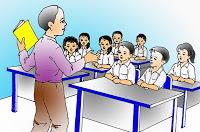 pak guru di depan kelas